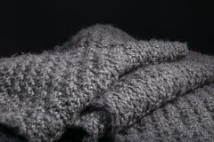 Knitted aisló el fondo doblado de la tela de las lanas Fotos de archivo libres de regalías