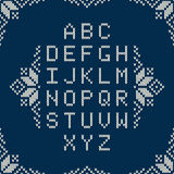 Knitted Alphabet on Seamless Fair Isle Style Background Stock Image