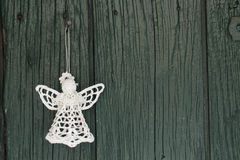 Knitted angel for christmas greetings card. On old green wooden background Stock Photography