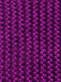 Knitted article. The texture of a warm soft knitted sweater or scarf royalty free stock image
