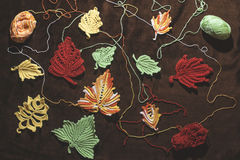 Knitted autumn leaves Stock Photos