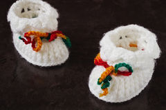 Knitted baby bootie Royalty Free Stock Image