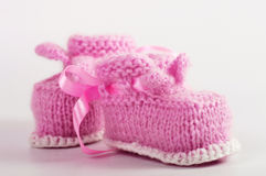 Knitted baby booties Stock Photo