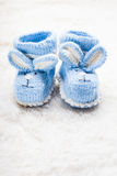 Knitted baby booties Stock Photography