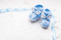 Knitted baby booties Royalty Free Stock Images