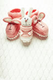 Knitted baby booties Stock Images