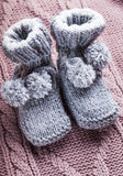 Knitted baby booties Royalty Free Stock Photos