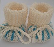 Knitted baby socks. Knitted handmade baby socks, in blue and white colors Stock Photography