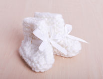Knitted baby socks on against the backdrop Royalty Free Stock Images