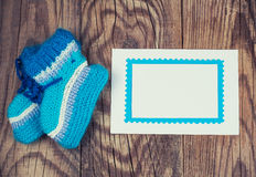 Knitted baby socks and blank Stock Photo