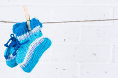 Knitted baby socks hanging Royalty Free Stock Photos