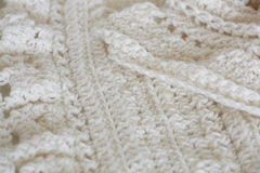 Knitted background. White knitted whool texture background Stock Photo