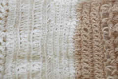 Knitted background. White and beige knitted whool texture background Royalty Free Stock Photos