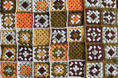 Knitted background, color squares Stock Image