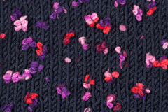 Knitted background. Dark blue knitted background with bright spots Stock Photos
