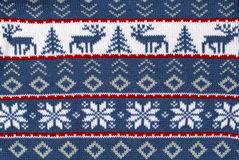 Knitted background with the deer. Blue knitted background with the deer Royalty Free Stock Photos