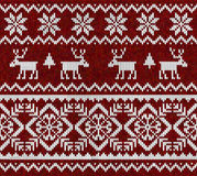 Knitted background with deer. Royalty Free Stock Photo
