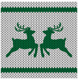 Knitted background with deer Royalty Free Stock Photo