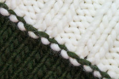 Knitted background diagonal white and dark green. Royalty Free Stock Photo