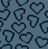 Knitted background with the image of hearts Stock Images