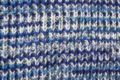 Blue knitted background. Knitted texture. A sample of knitting. Knitted background. Knitted texture. A sample of knitting from wool. Knitting Pattern Royalty Free Stock Images