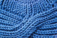 Blue knitted background. Knitted texture. A sample of knitting. Knitted background. Knitted texture. A sample of knitting from wool. Knitting Pattern Stock Photography