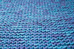 Blue knitted background. Knitted texture. A sample of knitting. Knitted background. Knitted texture. A sample of knitting from wool. Knitting Pattern Stock Image