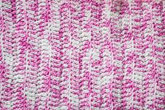 Pink knitted background. Knitted texture. A sample of knitting. Knitted background. Knitted texture. A sample of knitting from wool. Knitting Pattern Stock Photos