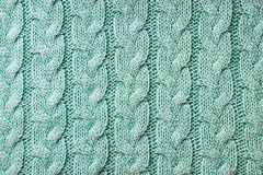 Turquoise knitted background. Knitted texture. A sample of knitt. Knitted background. Knitted texture. A sample of knitting from wool. Knitting Pattern Stock Photos