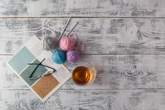 Knitted background with knitting needle and ball of yarn, knit i Royalty Free Stock Photo