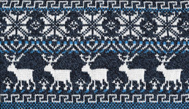 Knitted background with pattern with five deer Stock Photos