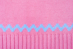 Knitted background. Pink wool jumper texture macro Stock Image