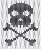 Knitted background with skull Royalty Free Stock Images