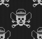 Knitted background with skulls  in a cowboys hat. Seamless Royalty Free Stock Photos