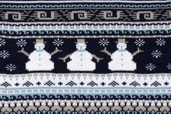 Knitted background with snowmen. Blue knitted background with snowmen Royalty Free Stock Photo