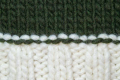Knitted background white and dark green. Stock Images