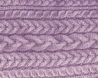 Knitted backgroung. purple lavender texture. knitting pattern of wool. cable element. Knitted backgroung. knitted purple lavender texture. knitting pattern of Royalty Free Stock Photography