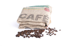 Knitted bag and coffee beans Royalty Free Stock Photos