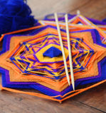 Knitted beautiful mandala. Shallow depth of field Stock Photo