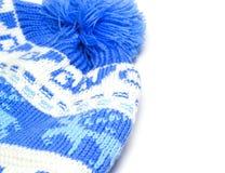 Knitted behandla som ett barn hatten Arkivbild