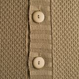 Knitted beige cloth material fragment Stock Image
