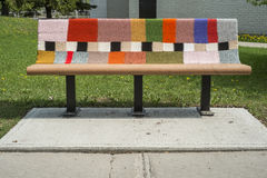 Knitted benche. In a public park on a sunny day Royalty Free Stock Photography