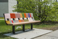 Knitted benche. In a public park on a sunny day Stock Photography
