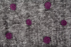 Knitted black mohair fabric with dots Royalty Free Stock Photos