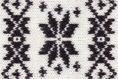 Knitted black and white Christmas ornament royalty free stock image