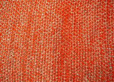 Knitted blanket orange. Christmas mood. The theme of the winter, warmth and comfort. Royalty Free Stock Photos