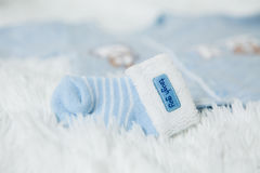 Knitted blue baby booties with rabbit muzzle for little boy Royalty Free Stock Photos
