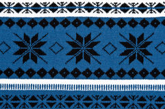 Knitted blue background with a pattern Royalty Free Stock Photography