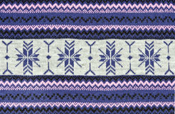 Knitted blue background with a pattern Stock Photography