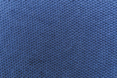 Knitted blue fabric background.Knited texture with pattern.Manuf Stock Image